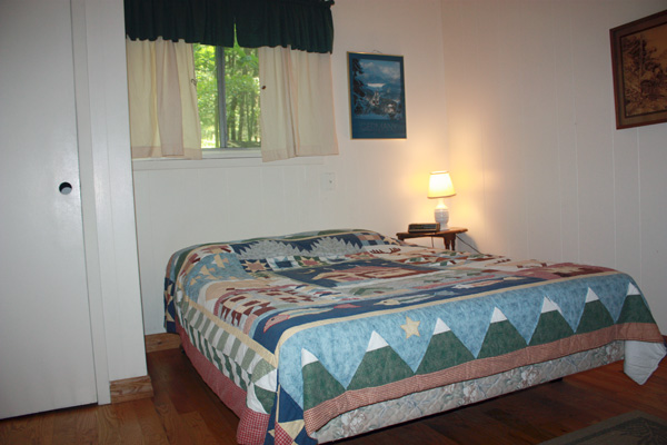 Wild Turkey Riverfront Cabins - Master Bedroom with Queen Bed