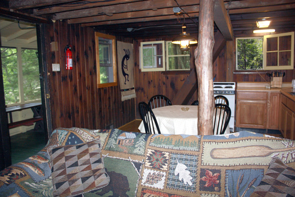 Wild Turkey Riverfront Cabins - View from Living Room (front porch, dining room and stairs to loft)