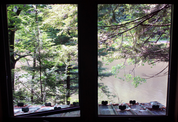 Wild Turkey Riverfront Cabins - View of River from Loft Bedroom